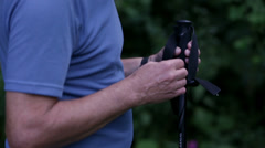 Detail shot of putting on the trekking poles Stock Footage