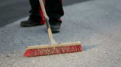 Man sweeping the floor with a broom - stock footage
