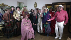 Group of people dressed in baroque costumes take a leap from the floor in slo-mo Stock Footage