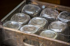 old fashon jars in a wooden box - stock photo