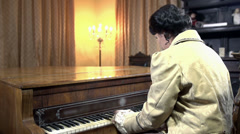 Woman in baroque clothes playing piano shot in slow motion Stock Footage