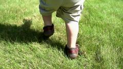 Toddler running - slow motion close up Stock Footage