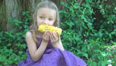 Child Eat a Boiled Corn in Park, Little Girl at Picnic, Healthy Food, Children Stock Footage