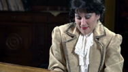 Stock Video Footage of Shot of the upper body of a female playing piano in romanesque clothes