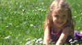 Laughing Child Playing in Grass on Meadow, Little Girl Flowers in Park, Children Footage