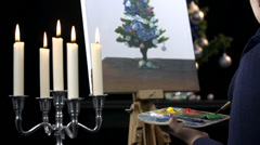 Artist painting Christmas tree in romantic theme Stock Footage
