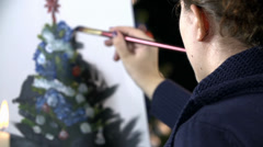 Female Artist painting Christmas tree in slow motion Stock Footage