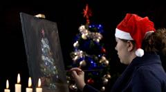 Creative artist painting Christmas tree - stock footage