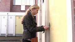 Locked door, wrong key, sad woman Stock Footage