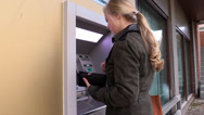Stock Video Footage of Woman withdrawing money at ATM, steadicam