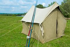 The tent from a canvas for fishing and tourism. legacy sample. Stock Photos