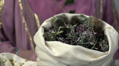 Sack full of green herbs Stock Footage