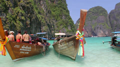 People in a boat at the beach at Phi Phi island Stock Footage