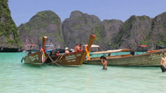 Boats at the beach at Phi Phi island Stock Footage