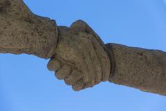 handshake realising the hand - stock photo