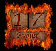 burning wooden calendar august 17. - stock illustration