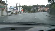Stock Video Footage of Drivers POV raining, narrow city streets