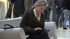Young woman using tablet in public Stock Footage
