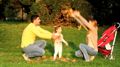 Parents having fun with kid in autumn park Stock Footage