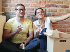Happy couple drinking champagne in their new flat Stock Footage