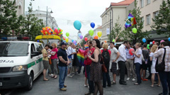 Gay lesbian parade participants with balloons and rainbow flags Stock Footage