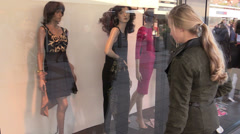 Shopaholic looking at clothes - stock footage