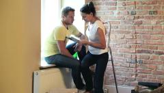 Couple decorating their new flat Stock Footage