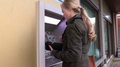 Woman withdrawing money at ATM, steadicam Stock Footage