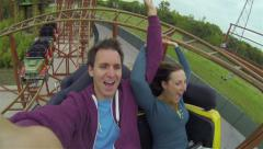 Young couple on a rollercoaster Stock Footage