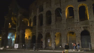 Stock Video Footage of Famous Colosseum forum Rome night people walk illuminated wall building ancient