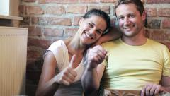 Happy couple smiling and showing the keys to the camera Stock Footage