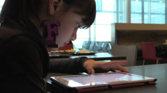 Girl using tablet computer at departure lounge Stock Footage