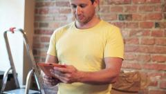 Happy man working on tablet and smiling to the camera Stock Footage