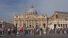 People Rome St Peters cathedral San Pietro church basilica facade panorama day Stock Footage