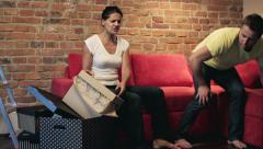 Angry woman arguing with her lazy boyfriend Stock Footage