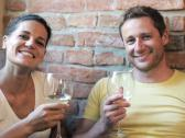 Stock Video Footage of happy couple drinking wine and smiling to the camera