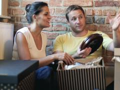 Couple unpacking things in their new flat Stock Footage