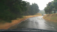 Driving POV rain, city outskirt Stock Footage