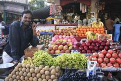 Indian man selling fruites at the market, bundi, india Stock Photos