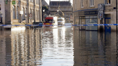 Emergency vehicles driving through flood water Stock Footage