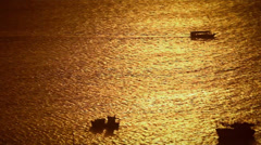 Boats at sunset Stock Footage