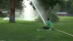 Firehose Fun with Kids Stock Footage