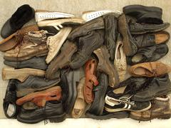 a large number of diverse old shoes - stock photo