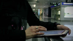 Moving escalator. She uses tablet pc Stock Footage