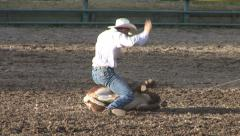 COWBOYS ROPING CALF AT RODEO IN ROCKY MOUNTAINS Stock Footage