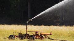 Slow motion irrigation sprinkler Stock Footage