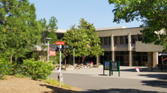 Paths leading to courtyard and campus building Stock Footage