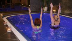 Women exercising in wellness and Spa swimming pool - stock footage