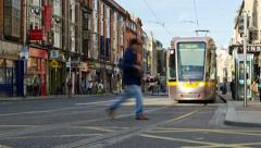 Time Lapse People Crossing Across Busy Traffic and Tram In Downtown. Stock Footage