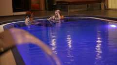 Women relaxing in wellness and Spa swimming pool - stock footage
